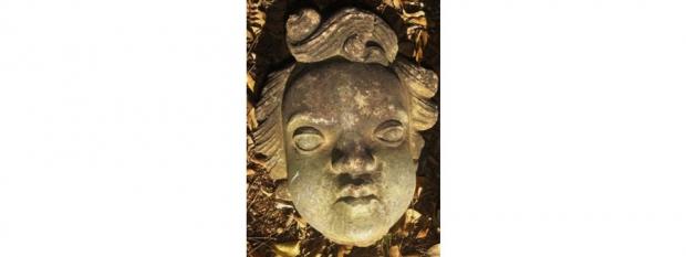 Stone Face Garden Figure