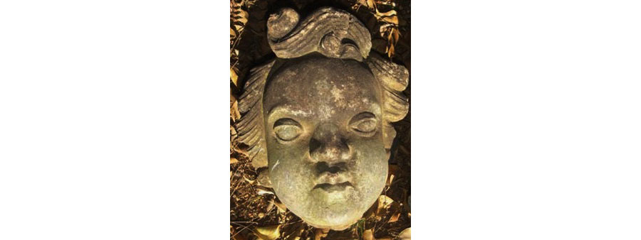 Carved Stone Faces And Masks