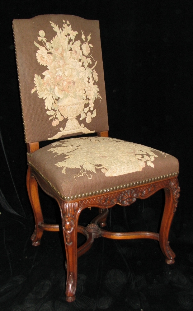 Set of 12 19c. French LXV style carved walnut dining with tapestry upholstered chairs (1)