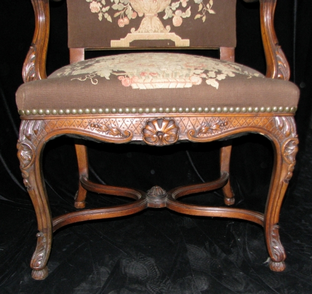 Set of 12 19c. French LXV style carved walnut dining with tapestry upholstered chairs (7)